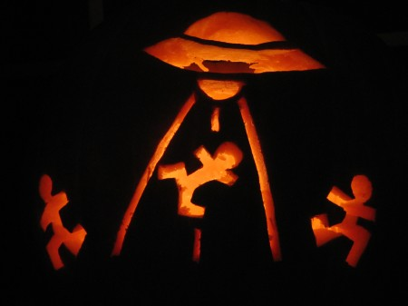 UFO abduction carved on a pumpkin
