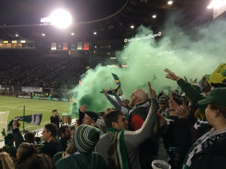 Green smoke is released to celebrate a goal